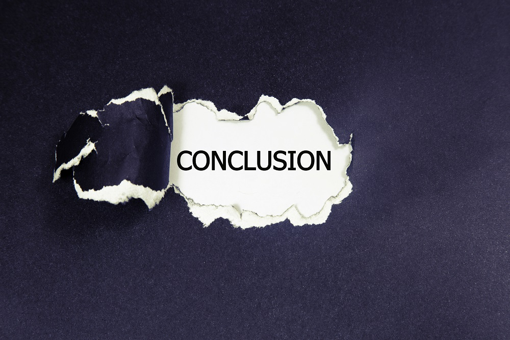 The text conclusion appearing behind torn paper