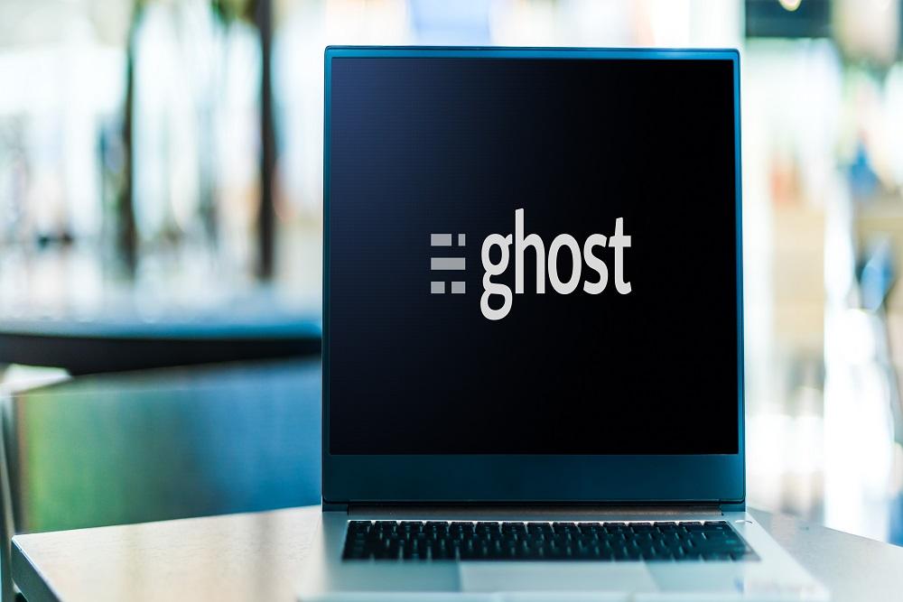Laptop computer displaying logo of Ghost